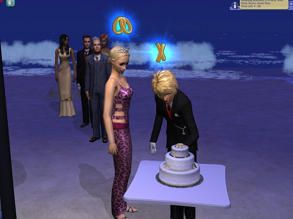 Cutting the cake, with the surf in the background