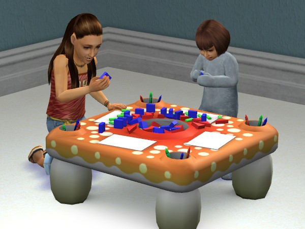Vanessa and Lilian playing blocks together