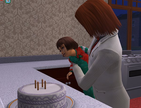 Lily blows out the candles